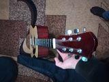 Vind ghitara acustica pastrata.
