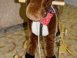 Продам музыкальную лошадку