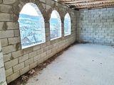 Casă în construcție,cotileț,1,5 nivele, 98m2, teren 11,13 ari, terasă,centrul localității