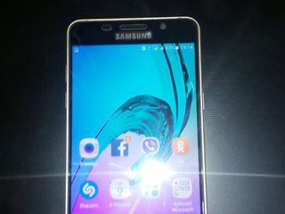 Samsung a5 510 f anul 2016 este practick nou...la schim pe iphone 6s