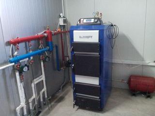 Системы отопления всех типов, котельные твердотопливные, комбинированные. Cazangerii combust. solid!