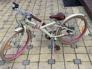 Se vinde bicicletă pentru copii de la 8 ani.