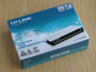 Новый, продам за 50% цены. TP-LINK TD-8840T 4-ports ADSL2+ modem router with splitter.