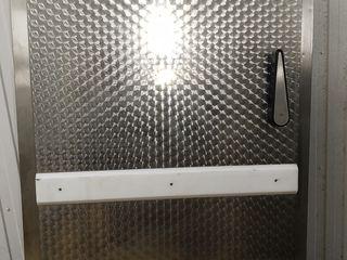 Дверь холодильной камеры