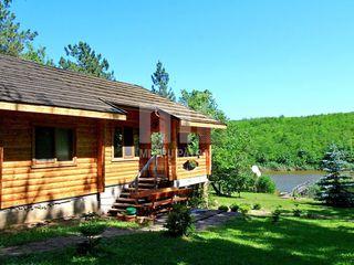 Propria casă pe malul propriului lac în pădure !!