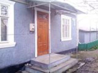 дом на земле в центре города, в хорошем состоянии, автономное отопление + 2 печи, 2 гаража, огород 6