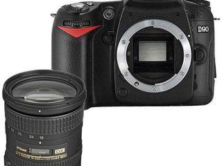 Nikon D90 18-200mm.
