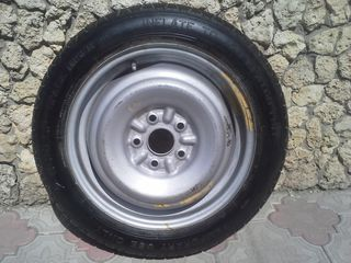 Запасное колесо на Toyota R16.roata de rezerva pentru Toyota R16
