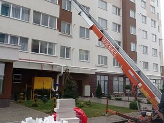 Ridicarea materialelor de construcții autolift hamali transport