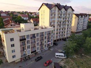 Cumpăr apartament la Stăuceni în casele de pe foto.