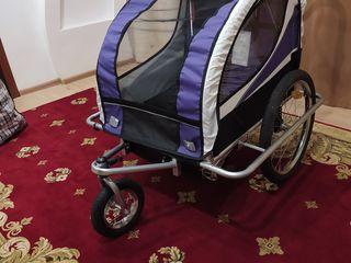 Vând cărucior pentru bicicletă