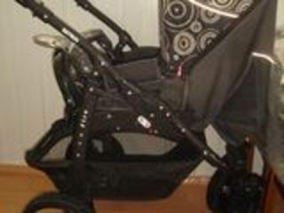 Фирменная коляска retrus fire вместе с люлькой ( Два в одном и зимняя и летняя )
