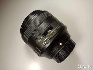 Pазные объективы Nikon .