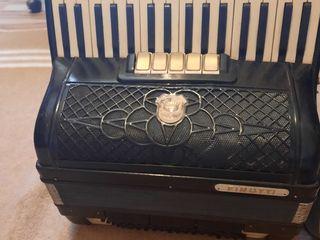 In vinzare acordeon firotti