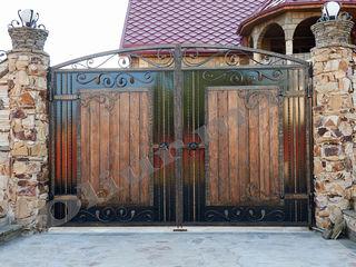 Balustrade, porți, copertine,  garduri,gratii, uși metalice și alte confecții din fier forjat.