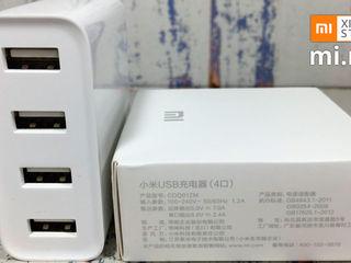 Заряжай 4 устройства одновременно благодаря зарядному устройству Xiaomi Mi Hub!