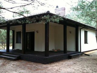 Новый дом с удобной планировкой и большой террасой