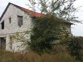 Продам участок земли с недостроенным домом