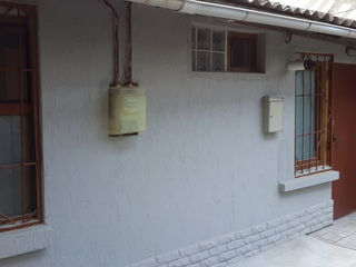 Ул. Тигина. Красивый, уютный дом, в самом центре города, есть гараж, и маленький участок земли.