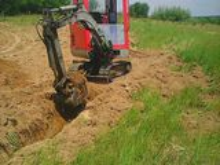 mini excavator la comandă