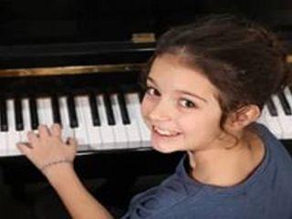 Преподователь консерватории обучает школы игры на фортепиано сольфеджио и вокал.