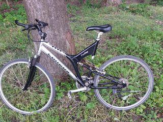 Vind bicicleta cu 2 amortizatoare