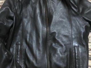 Куртки коженые новые