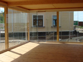 Sisteme glisante din sticlă pentru balcoane și terase