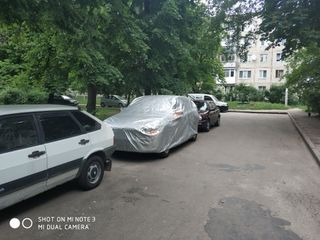 Автомобильный чехол, для машин / механизмов, стоящих под открытым небом. Capac de mașină.
