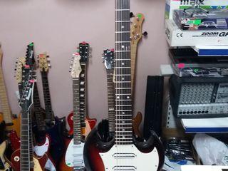 Фирменные гитары оригинальные в магазине Pro-Arta ул Пушкина 50А