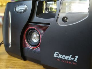 EKSEL !  пленка сделан в ЕС  1993 год оптика Япония --259 лей..KASI EXELIM  цифра 1999 год --150 лей