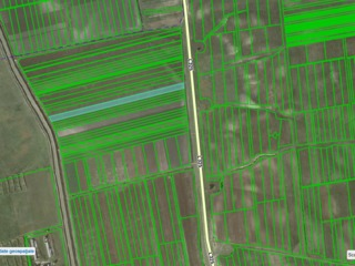 Teren agrar 26 hectare consolidate, drum asfaltat pina la teren...