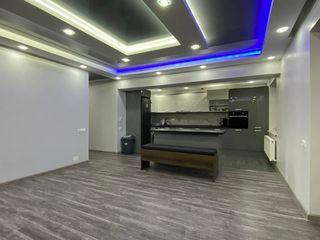 Apartament cu 2 odăi+living 90m2 +terasă 15m2,parcare subterană și debara în preț!!!