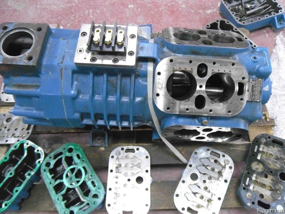 Синий компрессор в разборе без поршневых крышек