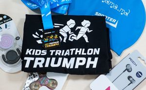 What gifts will Kids Triathlon Triumph participants get on the event day