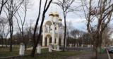 В Тирасполе мужчина учил сына стрелять из пистолета в парке