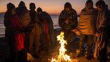 Чтобы спастись от холодов, мигранты жгут все, что попадется