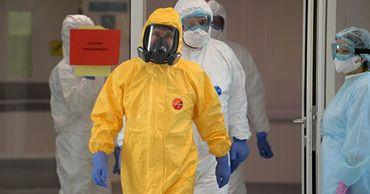 В больнице в Коммунарке рассказали, почему Путин надел желтый костюм.