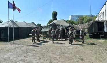 Военнослужащие Нацармии участвуют в тактических учениях.