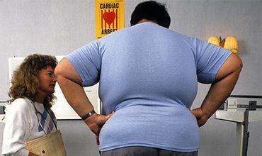 У людей с лишним весом повышенный риск возникновения рака.