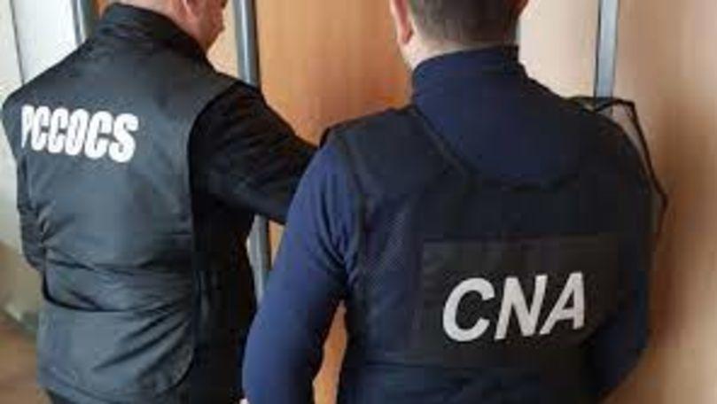 Frauda bancară. Percheziții la BNM: Telefoane confiscate și un reținut