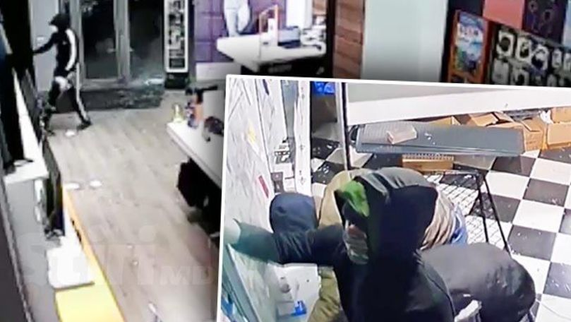 Tineri, filmați cum sparg magazine și fură telefoane de 500.000 de lei
