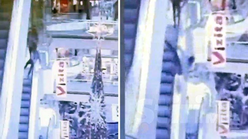 Momentul în care un tânăr cade în gol într-un mall din Chișinău, filmat