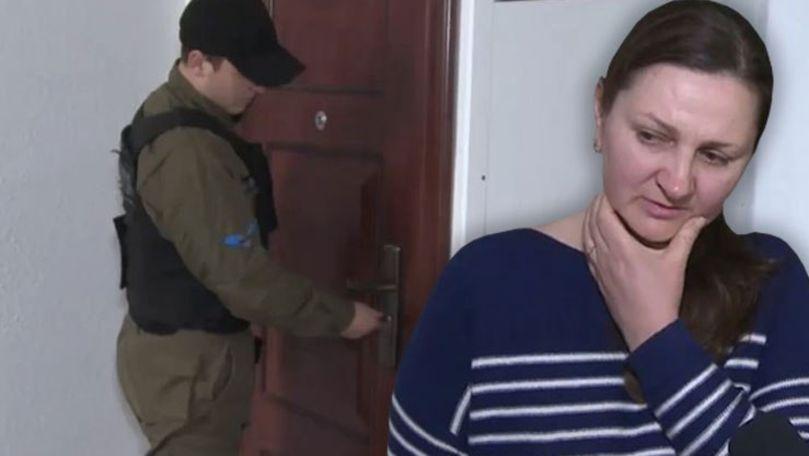 O mamă cu 3 copii, evacuată forțat din propriul apartament